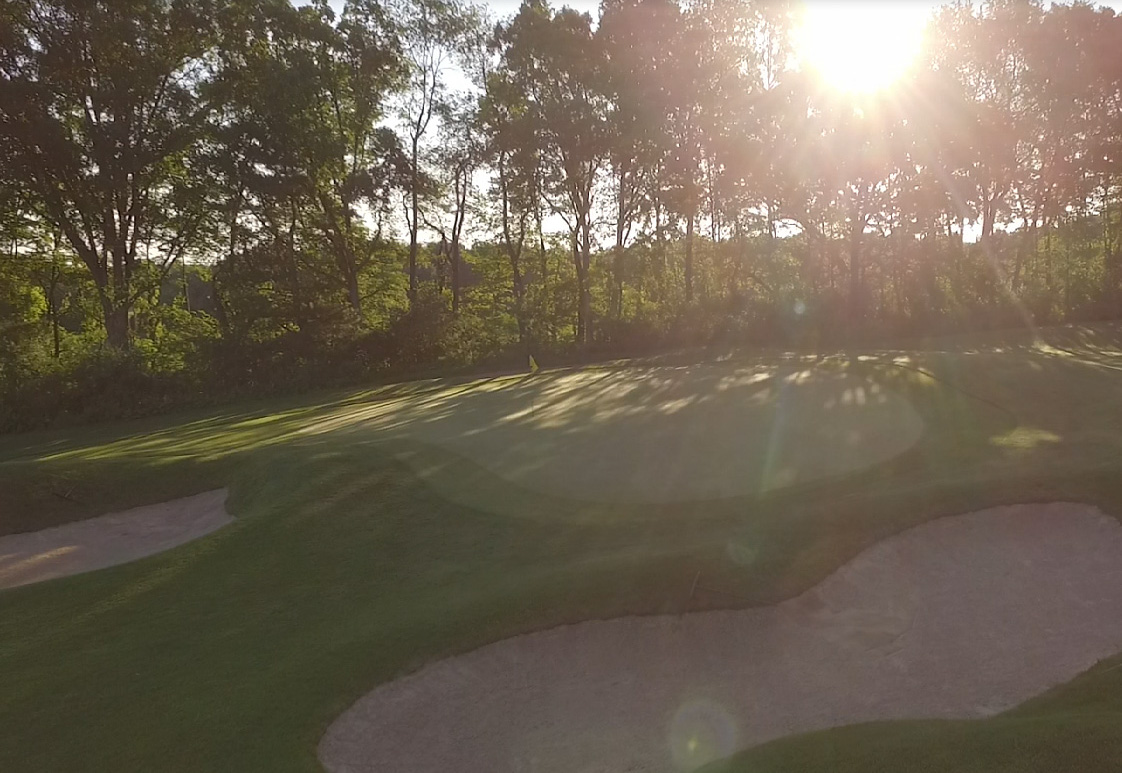 The sun sets on the course at Toftrees Golf Resort